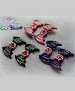creepy cute eyeball wings hair clips handmade with resin fairykei pastel goth